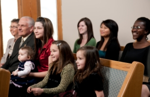 Parents teach their faith by sharing their faith in worship with their children.